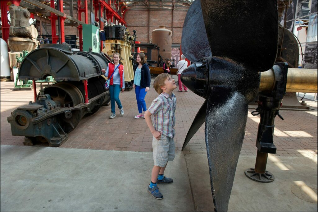Boy looking at maritime museum exhibit