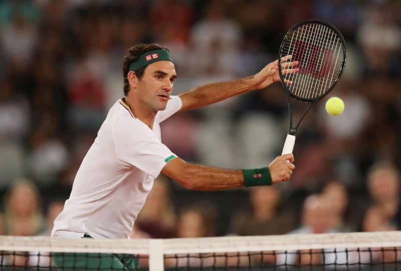 Federer vence a Evans en Doha en su primer partido en 14 meses