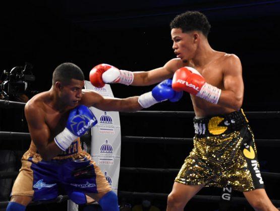 Boxeadores Puello y Rosa ganan pelea por título mundial