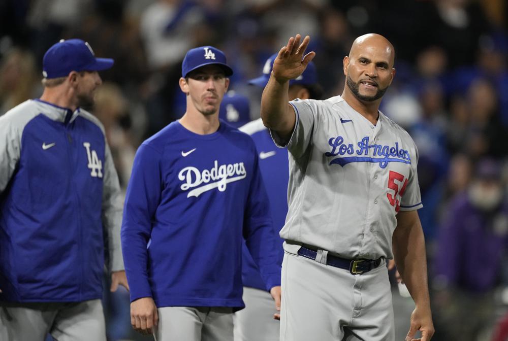 Con sencillo de Pujols en la 10ma, Dodgers vencen a Rockies