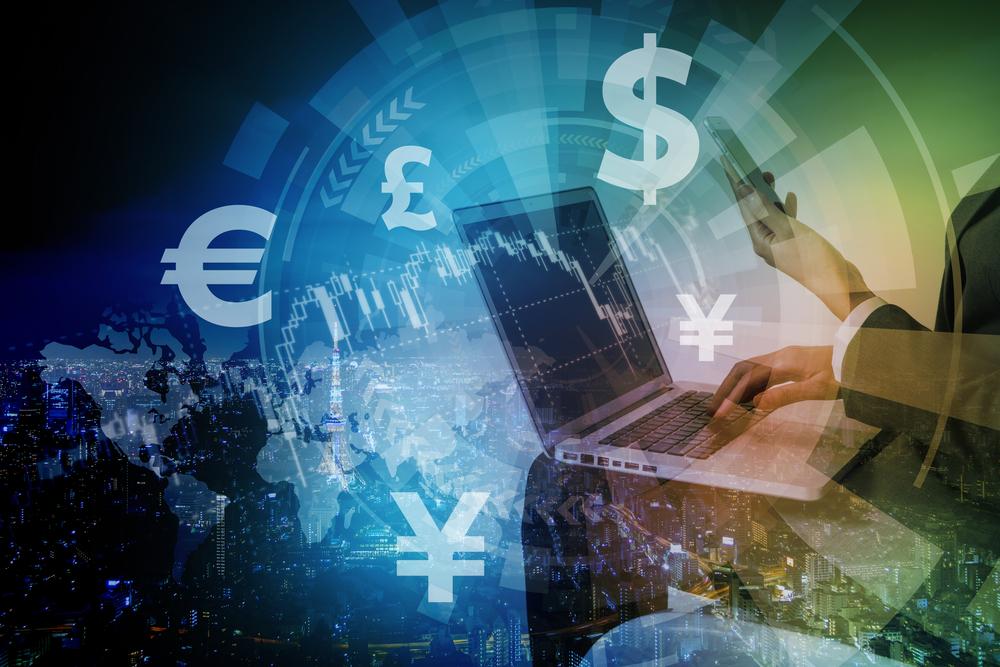 通貨マークとパソコン
