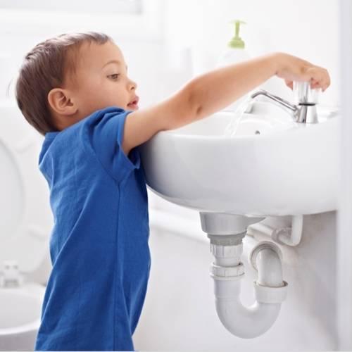 Boy at Bathroom Sink