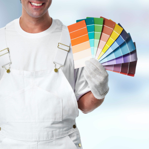 Man Holding Fan of Paint Swatches