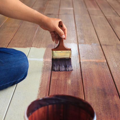 Person Staining Floor Boards