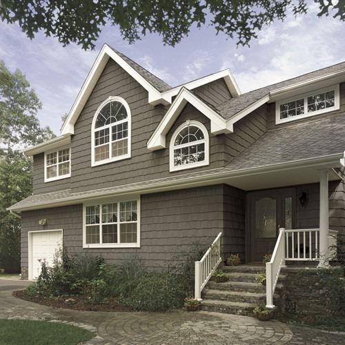 Upscale house with dark gray siding and white trim