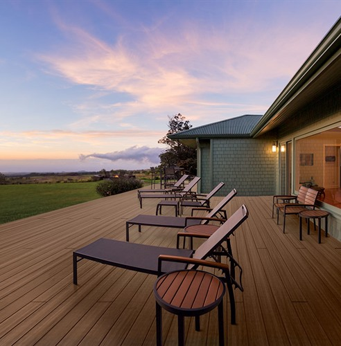 Deck at sunset with lounge chairs