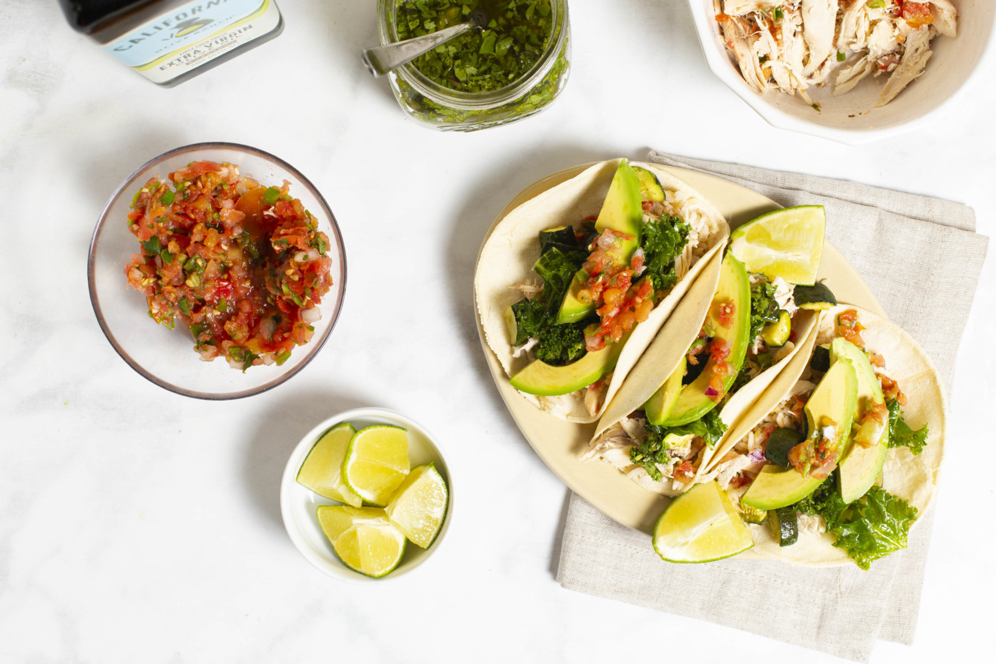 chicken tacos with kale, salsa, pesto, and avocado