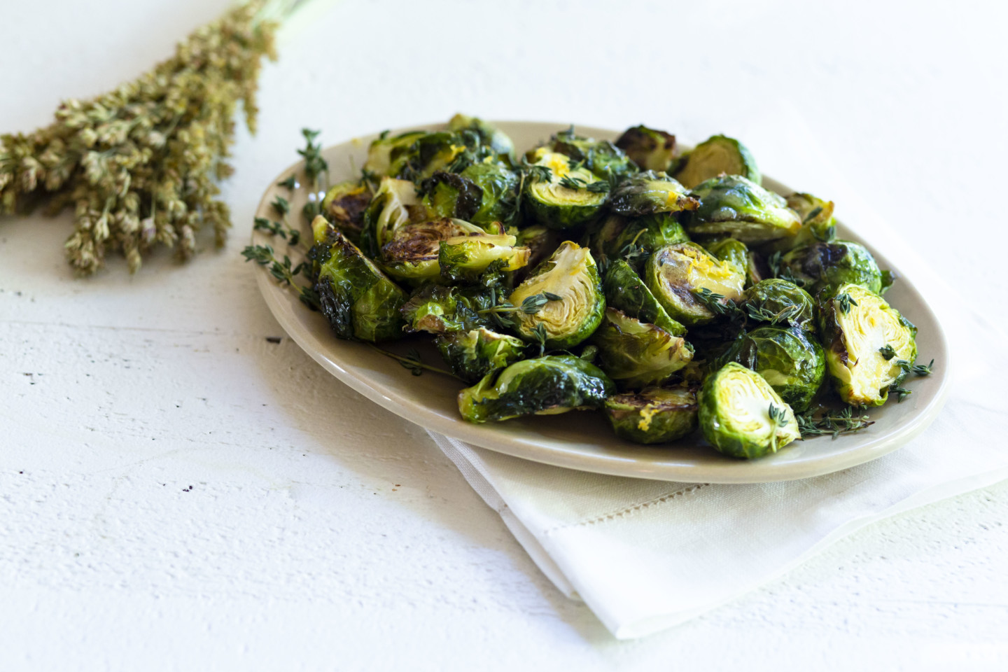 Roasted Brussels Sprouts with Lemon, Fresh Thyme, and California Olive Ranch Limited Reserve Extra Virgin Olive Oil