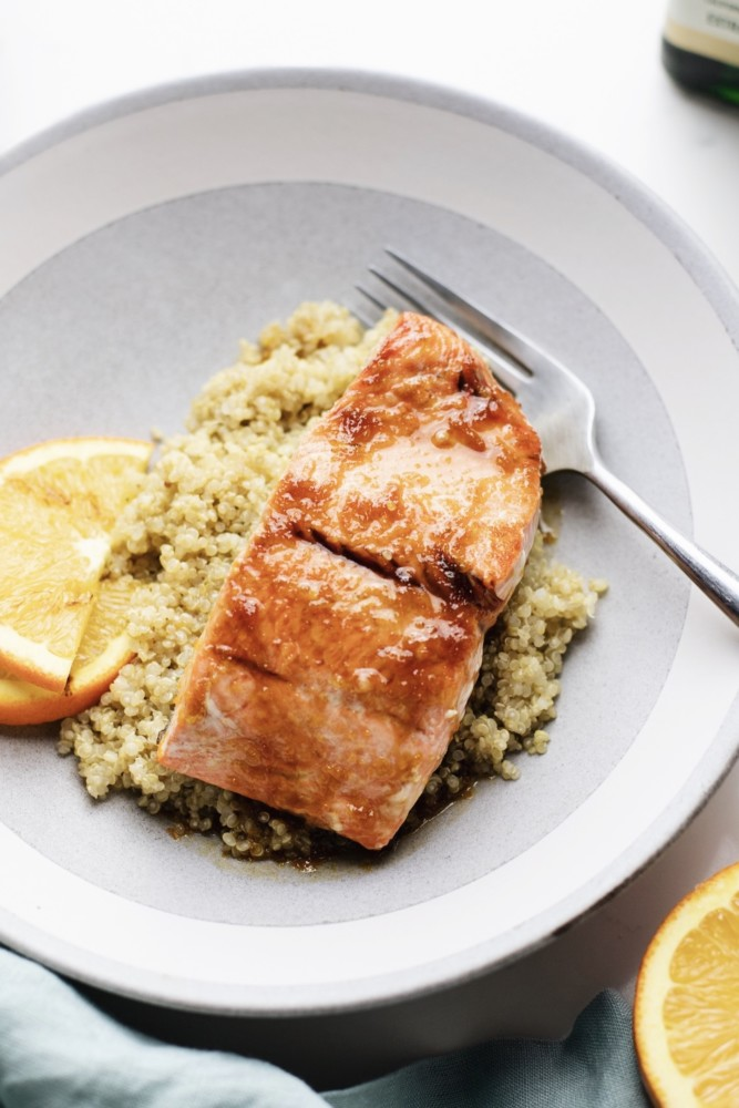 Close up of citrus glazed salmon over couscous