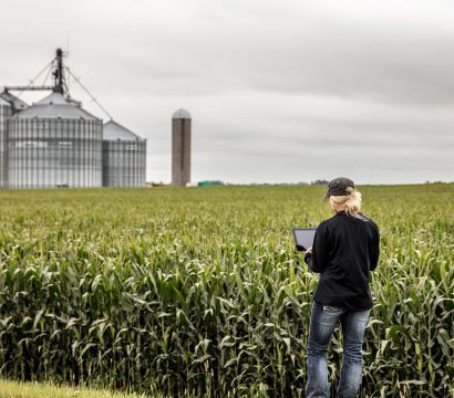 Farmer in the field using Granular Insights. Photo credit: Granular