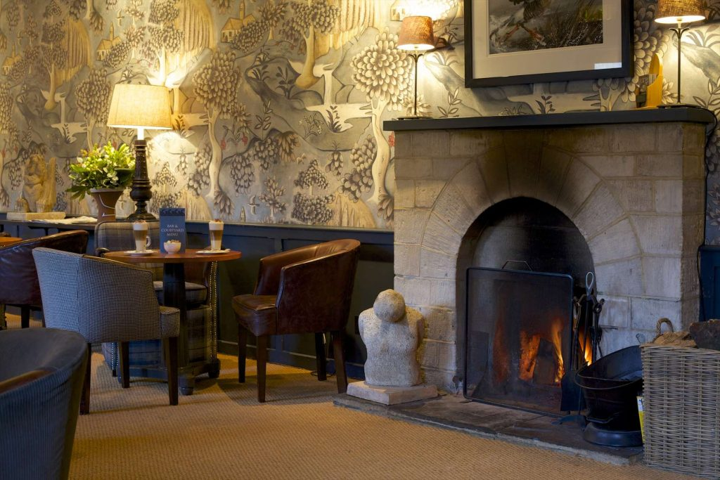 Swan at Bibury log fire