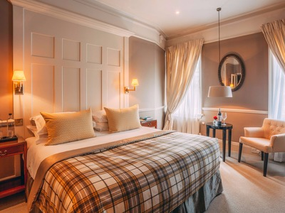 Deluxe King Room  + Chic Treats in Overview