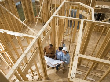 New home construction with buyers.