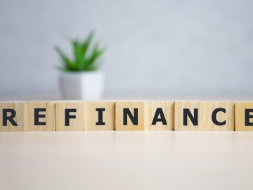 """Scrabble tiles spell out the word """"refinance."""""""