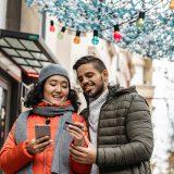 Couple checks credit card balance.