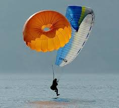 Round reserve parachute for paragliding and ppg
