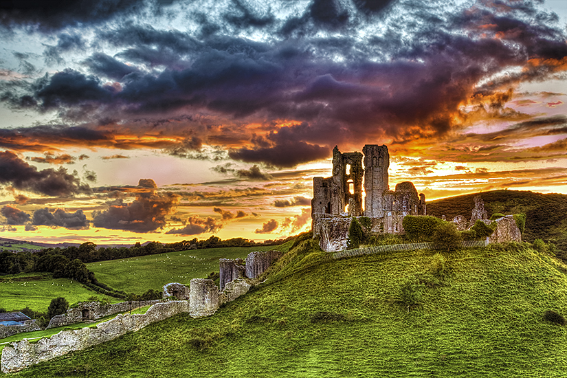 Dramatic sunset over Corfe Castle
