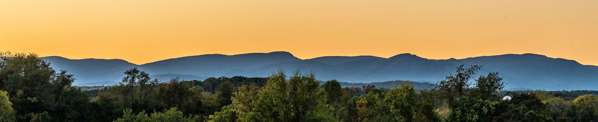 A wide photo of the Blue Ridge Mountains during sunset