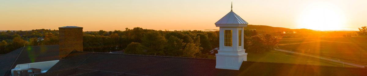 The roofline of The Culpeper at sunset