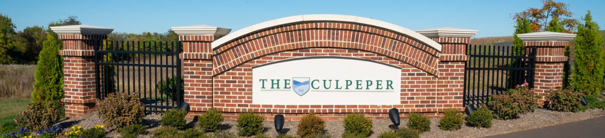 A photo of the brick welcoming sign to The Culpeper retirement community