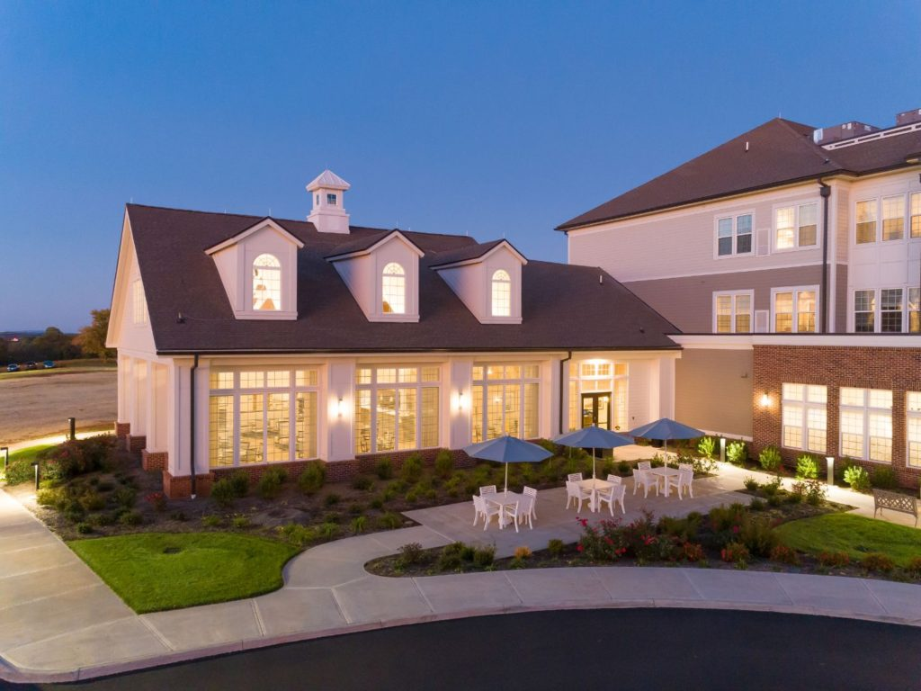 An exterior photo ofThe Culpeper senior living fitness room and outdoor seating