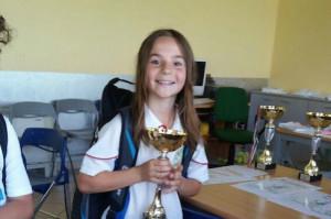 Giovane atleta del Tennis Club Busca alle finali di Roma del Master Kinder sport+