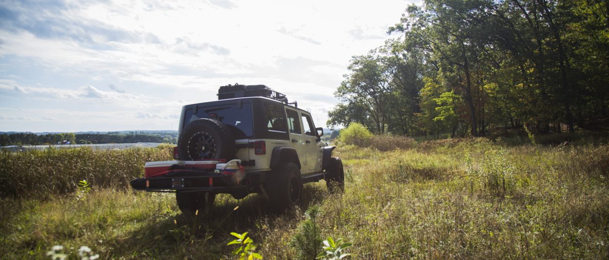 CURT hitch cargo carrier and rooftop cargo carrier on Jeep