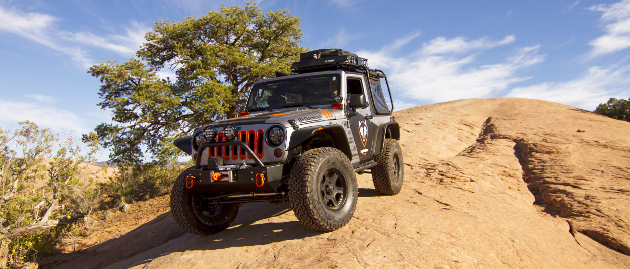 CURT rooftop cargo carrier on offroad Jeep Wrangler