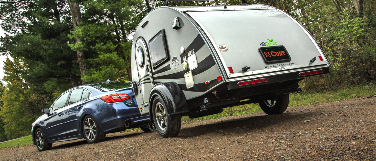 Car with class 1 hitch from CURT towing teardrop camper