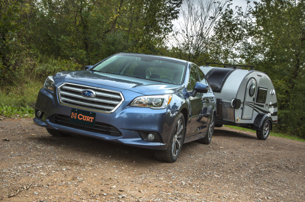 Subaru car towing teardrop camper with CURT class 1 trailer hitch