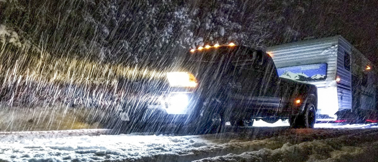 CURT hitch on Ram truck towing camper in snow