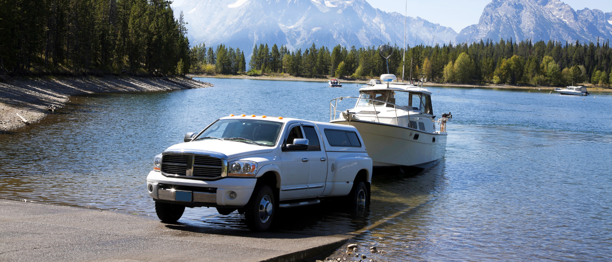 CURT trailer hitches - Dodge Ram truck launching boat into lake