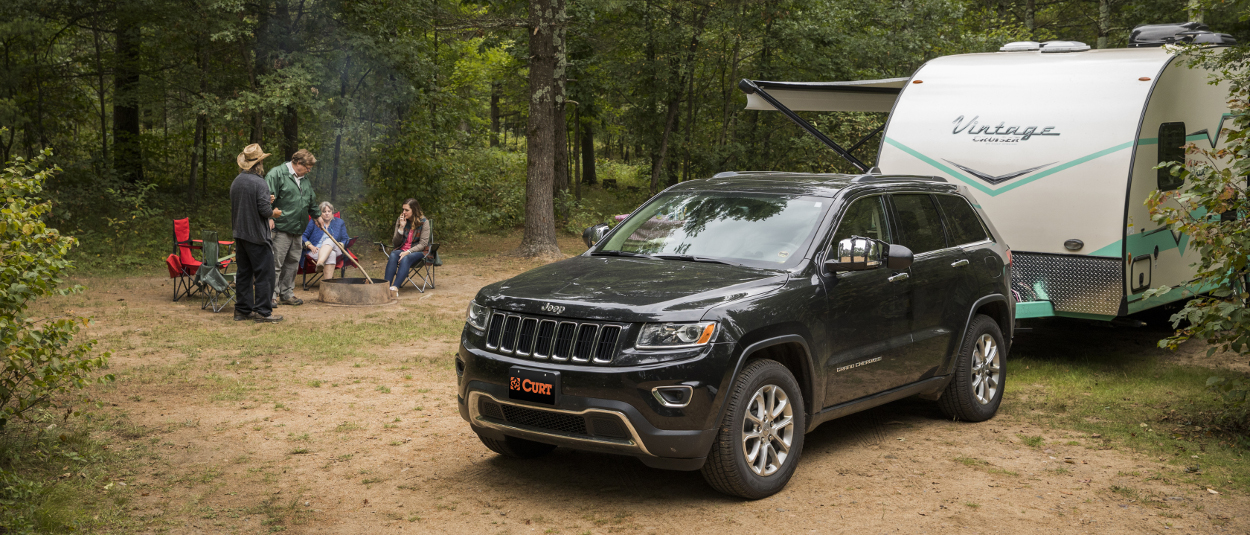 CURT trailer hitches - family camper at the campsite - Jeep Cherokee