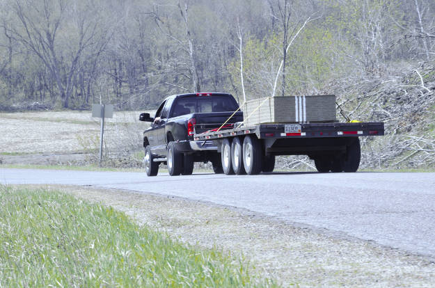 Dually Truck Towing Heavy-Duty Flatbed Trailer