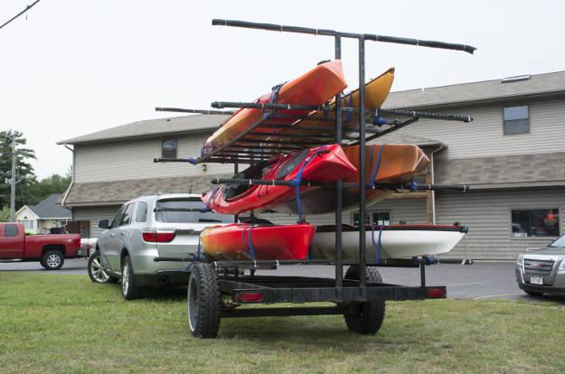 SUV Towing Kayak Trailer in Parking Lot