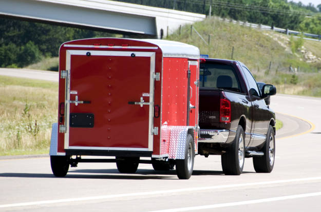 Truck Pulling Enclosed Utility Trailer