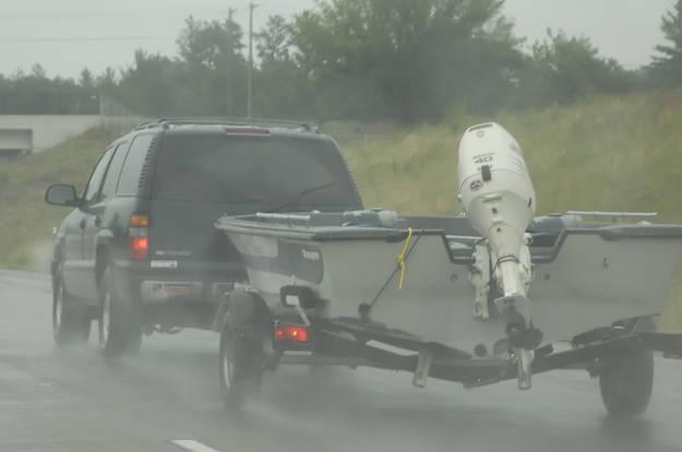 Truck Towing Boat Trailer in Rain