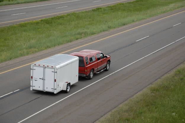 Truck Towing Utility Trailer on Highway