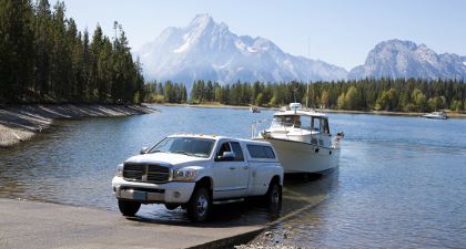 Dodge truck launching boat - mountains
