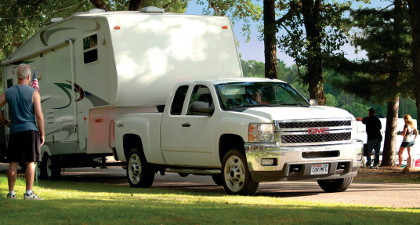 GMC truck towing 5th wheel camper