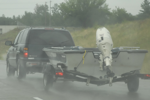 SUV towing fishing boat