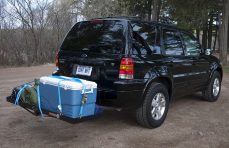 SUV with bumper hitch and cargo carrier