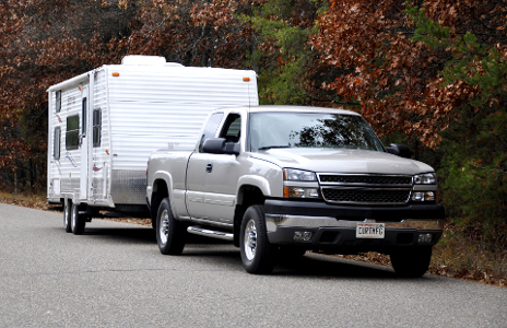 GM truck with class 4 hitch towing large camper