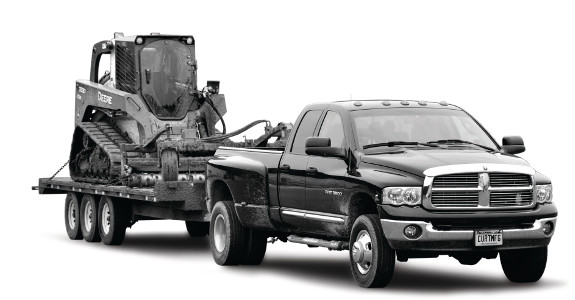 Ram truck towing heavy-duty flatbed trailer