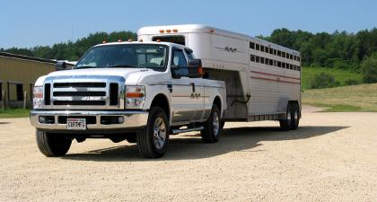 Ford Super Duty truck towing gooseneck livestock trailer