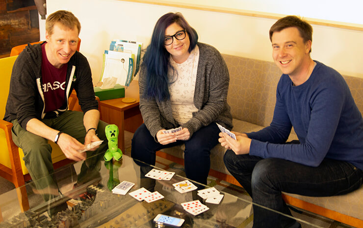 Scott, Kat, and Tim take a quick break for a game of cards