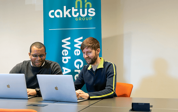 Caktus developers working together