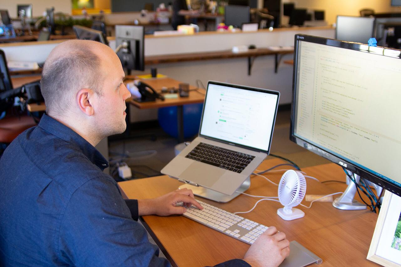 Mobile developer working at desk