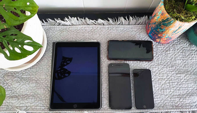 Various mobile devices, including an iPad and iPhone, used for accessibility testing