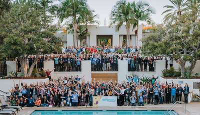 Outdoor photo of a group of hundreds of DjangoCon attendees